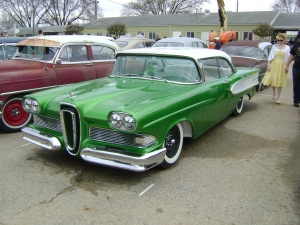 This car is a custom. It is identified as such because it is based on a 1950's car and has clean paint, is lowered and has a clean interior but does not have billet rims.