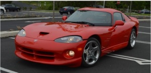 This is a 2001 Dodge Viper I found for sale on EbayMotors for $31k. The MSRP on this car new would have been anywhere between $65k-$75k. It has 15k miles which basically is a new car. For window shopping purposes, you can buy this Viper or a brand new V8 Camaro or Mustang for the same price. The Dodge will probably cost more for insurance and replacement parts. The upside of car like this is there will be thousands of other Camaros and Mustangs. How many Dodge Vipers will you see on the road? Not many.