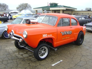 """This car is easily identified as a gasser because of it's """"nose high"""" stance and slicks. The name, """"Wicked"""" also is a nod to vintage race cars often being named. The hood scoop and lack of billet rims are also both good indicators that this is a gasser."""