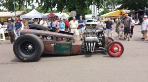 If you look closely you can see the super charger does not actually have a belt driving it, thus making the super charger non-functional. The rust finish and general cartoon-like appearance allude to the fact that this car is definitely a rat rod. - I love this car. It demands attention, which is the goal of a rat rod.