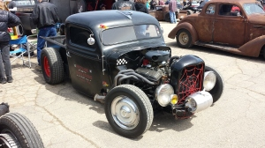 A rat rod with long tube headers.