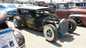 This is a Model A Ford Sedan with header wrap. It's barely visible behind the front tire, but it was the best picture I had, and again, sweet car. Picture is justified in my blog!