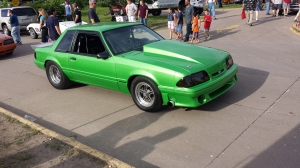 Cool drag race Mustang. This looks like a serious performance machine which distinguishes it from a pro-street style car, which are often built to look like they are fast but sometimes are, sometimes aren't.