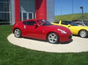 Picture showing the variety of sports cars, Nissan 370Z and an 80's Corvette