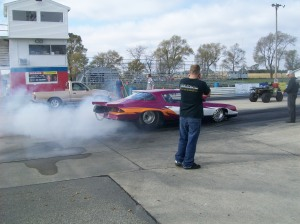 burnout before drag racing to clean tires, get them hot, and help you stick to the track