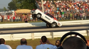 Awesome Barracuda pulling a wheelie at the drag strip.