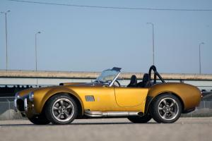 http://www.cardomain.com/ride/3925335/1965-factory-five-65-roadster/