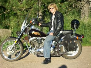 "This is a stereotypical Harley ""Cruiser"" 1989 Harley Davidson Softail Custom. This is a pretty generic crusier. It has a large seat. The foot pegs are in front of the rider. It has mini ape hanger handle bars. The rider sits in a slightly reclined position. This is me, 2010, I think. Don't judge too much!"