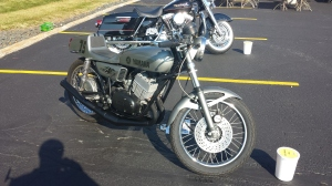 Yamaha Cafe racer. Notice the clip on handle bars. The seating position under the rider and the solo seat parallel to the ground.