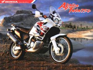 Honda Adventure bike.  http://qnbikes.files.wordpress.com/2013/06/honda-africa-twin_adventure_bike_poster.jpg?w=640&h=480