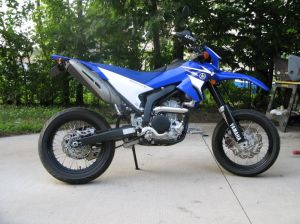 WR250 Supermoto. See the street tires and exhaust, headlights and turn signals.